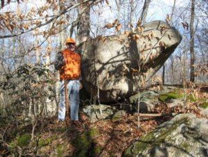 Rick Prescott in front of a boulder