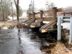 At noon, 3/31, the water level was 21 inches below the bottom of the side brace planks